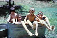 Donna, Gator, Corrine, and Jason in outdoor tub